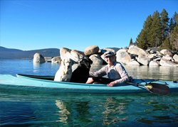 Owner and her 2 dogs in kayak on water